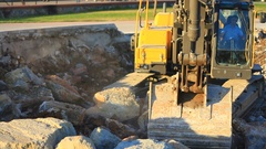 (Close up view) Excavator arm picks up the rocks. Stock Footage