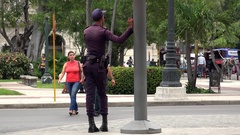 Cuban policeman on duty at the Havana central park (Parque Central). Stock Footage