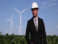 Businessman Walking Answer Question Wind Turbines Clean Electricity Production Stock Footage
