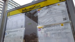 Information notice board, BVG bus station timetable, Berlin, Germany Stock Footage