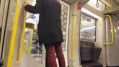 U-bahn subway public transport train arrives at station, man gets off, Berlin Stock Footage