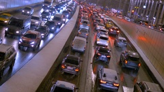 The slow movement of vehicles on city streets. In evening time Stock Footage