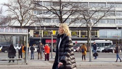 People wait at bus station, Mcdonald's, Zoo station, Berlin, Germany Stock Footage
