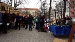 People shop at Berlin flea market, vintage stalls, Berlin, Boxhagener Platz Stock Footage
