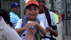 Cuban boys posing on camera at the Havana Malecon. Cuba Stock Footage