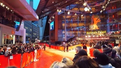 Many fans wait behind red carpet barricades, Berlinale film festival, Berlin Stock Footage