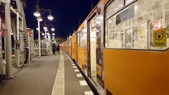 Yellow U-bahn public transport train at station platform, Berlin, Germany Stock Footage