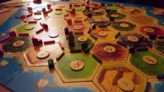 Playing Settlers of Catan board game Stock Footage