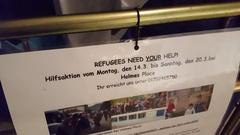 Refugees need your help, advert in German, donation, volunteer, Berlin Stock Footage