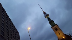 TV tower and church of Saint Maria in Berlin, night time, Germany Stock Footage