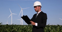 Businessman Ceo Holding Clipboard and Taking Notes About Wind Turbines Activity Stock Footage