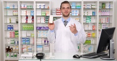Pharmacist Man Talking on Drugs Medicine Pharmaceutical Marketing Concept Shop Stock Footage