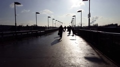 Sillhoute of pedestrian people walking, Warschauer Sbahn train station, Berlin Stock Footage