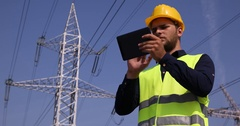 Electricity Service Engineer Man Use Digital Tablet Examine Inspect Energy Pylon Stock Footage