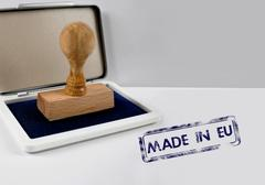 Wooden stamp on a desk MADE IN EU Stock Photos