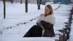 Beautiful young model hand warms. Very cold, winter, snow, wind Stock Footage