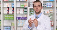 Druggist Man Talking Camera and Serious Answer to a Question Pharmaceutical Shop Stock Footage