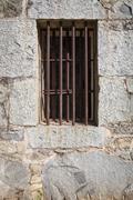Old Stone Jail House Window with bars Kuvituskuvat