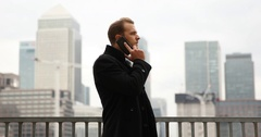 Chief Executive Officer Man Talking Mobile Phone Canary Wharf London Skyline Day Stock Footage