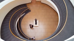Spiral stairs, people walk into art gallery, aerial view, Berlin, Germany Stock Footage