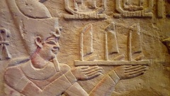 Egyptian hieroglyphics, man holds boats, ancient writing system, Berlin Stock Footage
