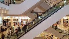 Escalators, huge department store shopping mall, elevator ride, Leipzig Stock Footage