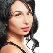 Portrait of a beautiful young dark-haired woman Stock Photos