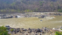 Tourists rafting on holy Ganges river, Himalaya mountains, Rishikesh, India Stock Footage