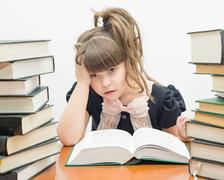 Little tired girl with books Stock Photos