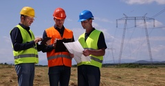 Engineer Men Walk Browsing Use Clipboard and Scheme Plan Energy Power Discussion Stock Footage