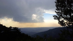 Cloud pours heavy rains in the horizon, Himalaya mountains, Bhagsu, India Stock Footage