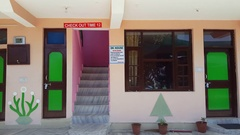 Colorful budget hotel guesthouse, checkout time 12 sign, Bhagsu, India Stock Footage
