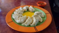 Plate of traditional tibetan dumplings, Momos Stock Footage