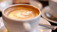 Frothy Latté Extreme Close-Up With Blurry Background Stock Footage