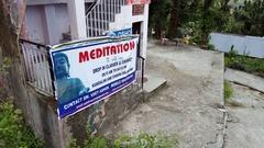 Meditation classes and courses school tourist sign, Bhagsu, Himalayas, India Stock Footage
