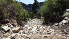 Dry river road path, Bhagsu, Himalaya mountains, India Stock Footage