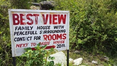 Hotel guesthouse lodging rooms with view sign, Bhagsu, Himalayas, India Stock Footage