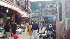 Busy street, crowd of people walk, tourists, Himalayas, Bhagsu, India Stock Footage