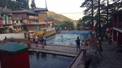 Indian tourists swim, Bhagsu Naag Temple swimming pool, Dharamsala, India Stock Footage