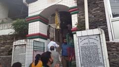 Indian people ring bell, worship at Bhagsu Naag Temple, Dharamsala, India Stock Footage