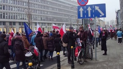 WARSAW, POLAND - DECEMBER, 17, 2016. Crowd with Polish and EU flags marching in Stock Footage