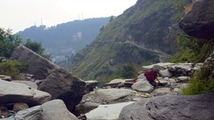 Tibetan buddhist monks washes, Himalaya mountain river, Dharamsala, India Stock Footage