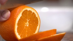 Juicy orange being sliced shot over cranked Stock Footage