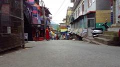 Tibetan buddhist monks walk down street, Mcleod Ganj, Dharmasala, India Stock Footage