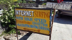 Internet Surfing sign, cafe, email, printing, computer service, India Stock Footage