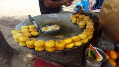 Indian street food, potato patties fried in oil, India Stock Footage