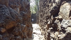Small narrow stone corridor, Rock Garden of Chandigarh, India Stock Footage
