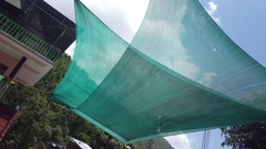 Green shade nets protect from sun Stock Footage