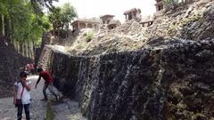 Village sculptures, waterfall, tourists, Rock Garden of Chandigarh, India Stock Footage