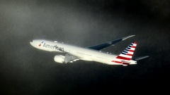 Airplane in flight aerial from above american airlines Stock Footage
